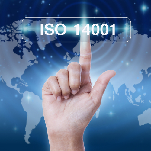 ISO 14001, with earth in the background and a hand