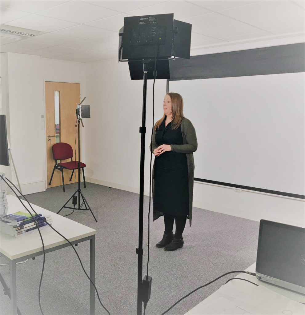 Behind the scene shot of Elizabeth Kenyon filming content for RRC