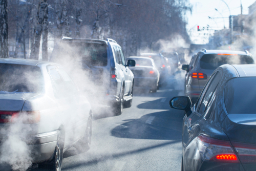 Vehicles in Traffic releasing emissions into the atmosphere - Urban area