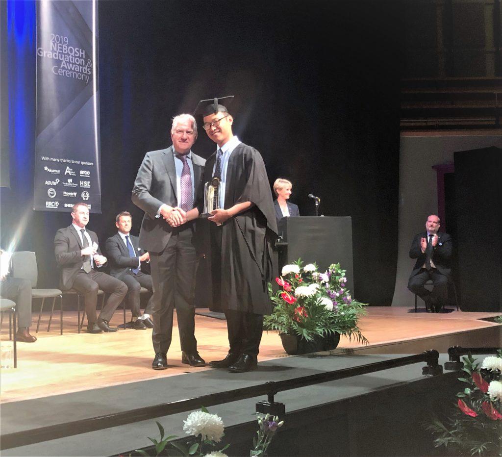 RRC Tutor Allan Ferguson (right) presenting the Award to the Best NEBOSH International General Certificate Candidate