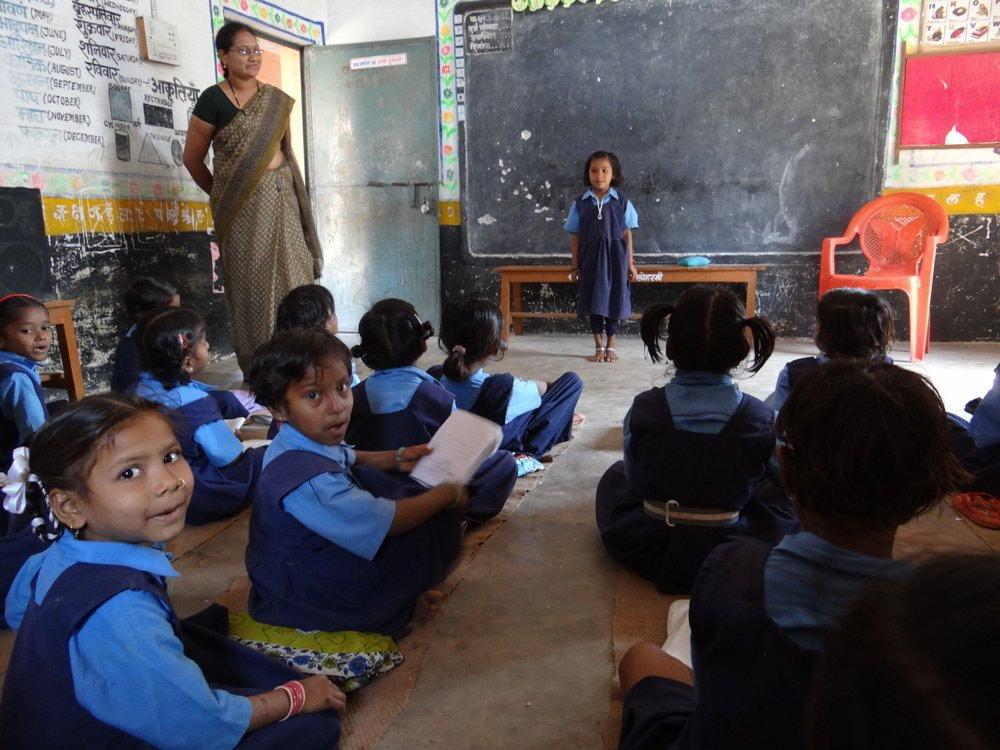 rural teacher in a primary class