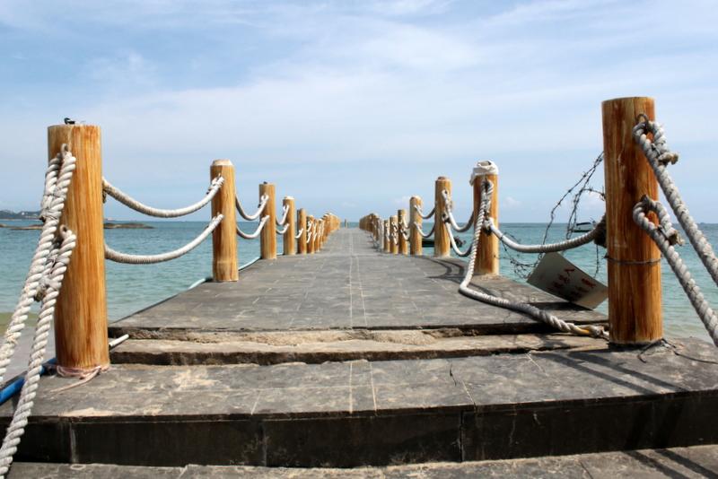 A well-worn pier on the beach at Yunlong Bay, Wenchang, Hainan