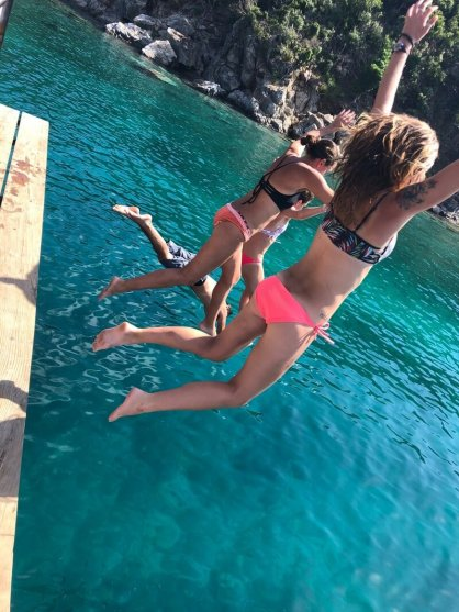 willy-t-girl-jumping-sailo-boat-yacht-rentals-bvi