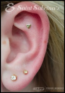 Helix piercing with yellow gold heart from BVLA