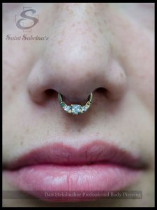 Septum piercing with princess gem septum clicker