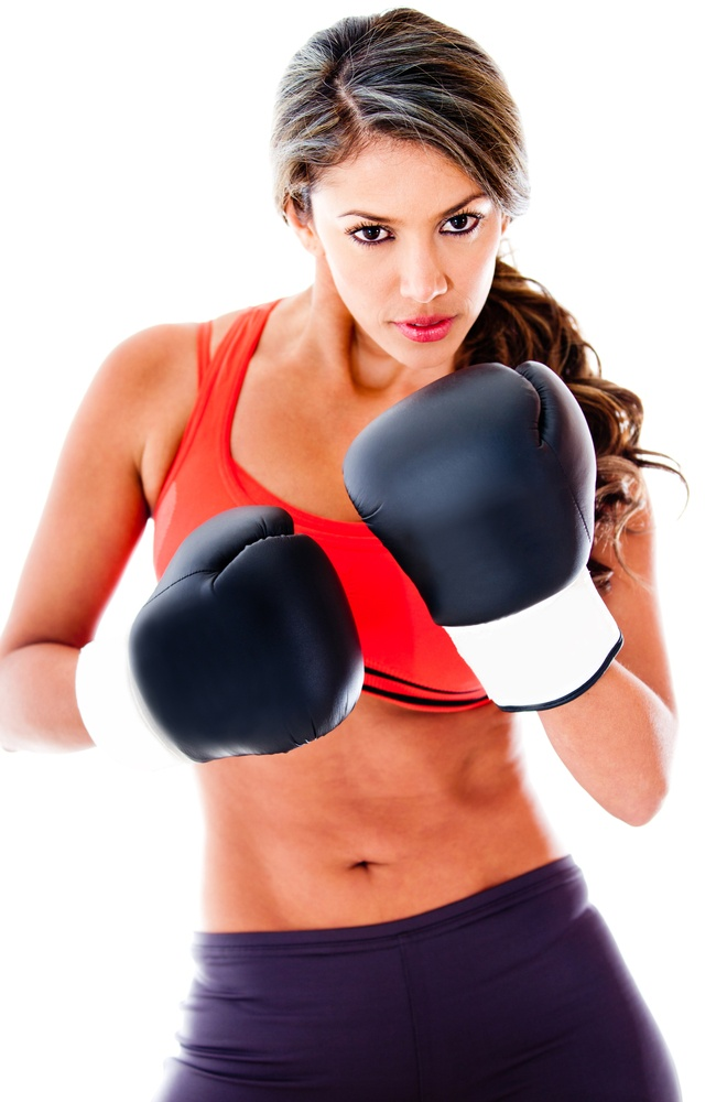 Fit woman boxing isolated over a white background