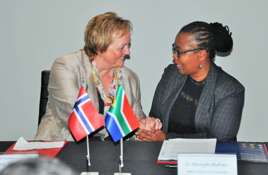 Signing a historic bilateral agreement on establishment of a centre to fight illegal fishering at the Nelson Mandela Metropolitan University in Port Elizabeth are (Left) Norway's ambassador to South Ms Trine Skymoen and Dr Sibongile Muthwa, acting Vice President of the NMMU