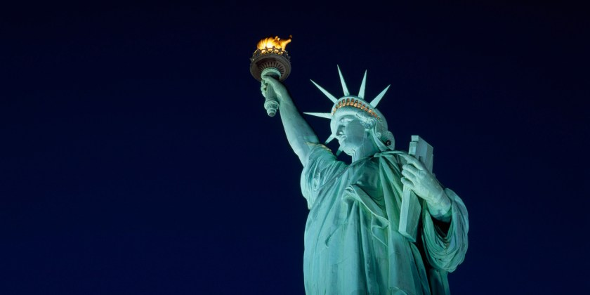 Low angle view of a statue lit up at night, Statue of Liberty, New York City, New York, USA
