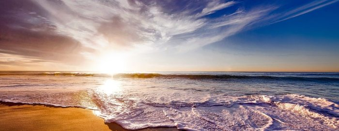 Shot of the ocean waves lapping the shore at sunset.