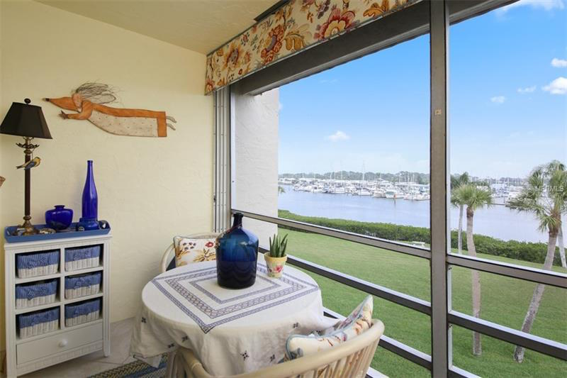 Screened-in patio with a view of the water.