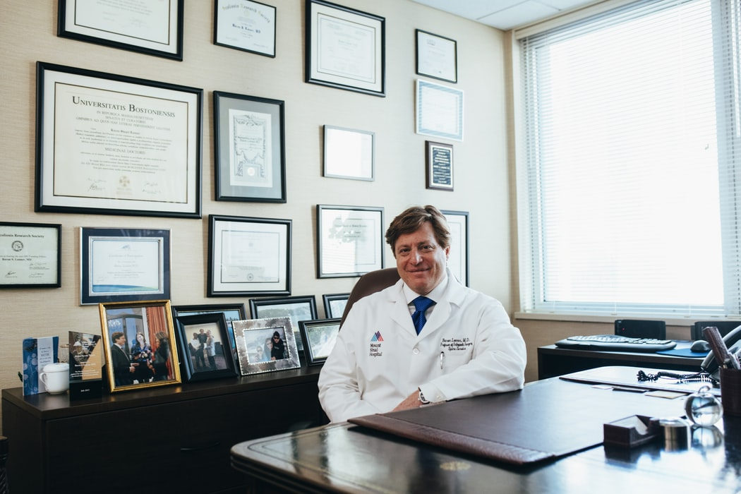 A doctor sitting behind his desk.