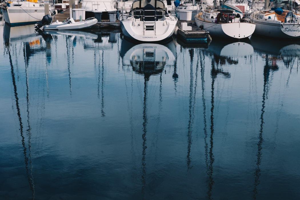 A collection of boats in a marina.