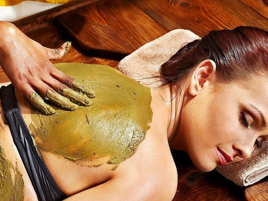 Woman getting a massage at Locally-Owned Sarasota Businesses
