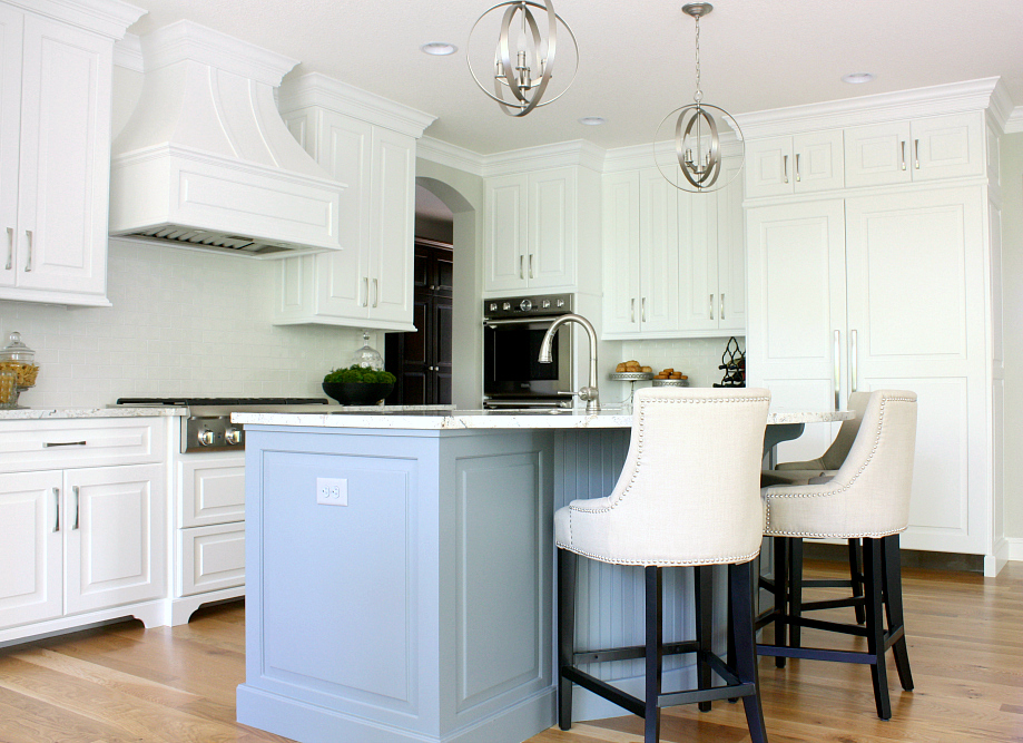 Twin Cities Artisan Home Tour - White kitchen with blue island - pendant lights.
