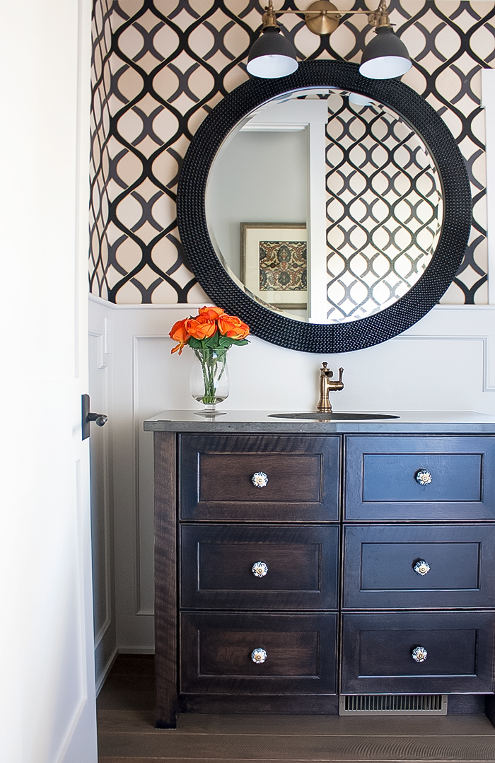 decorating with wallpaper in the bathroom. Wainscoting and graphic print