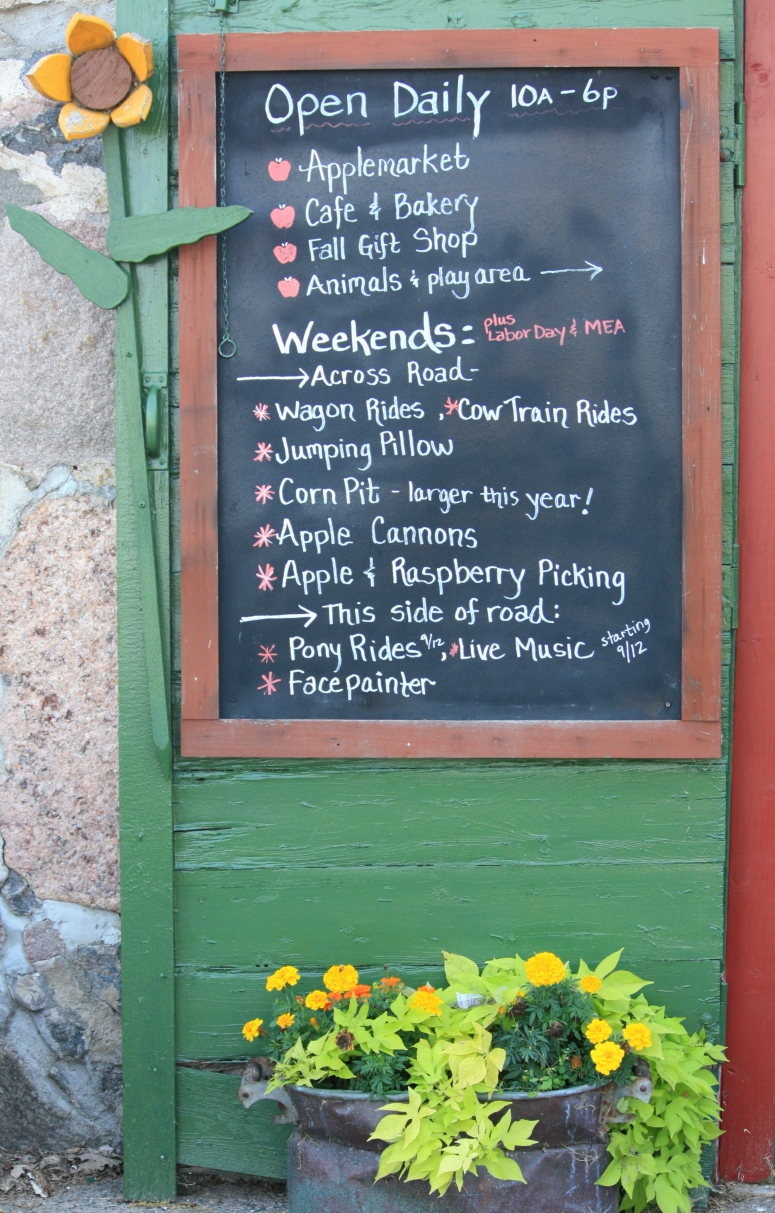 Apple Jack Orchard Hours and Events chalkboard sign - apple orchard
