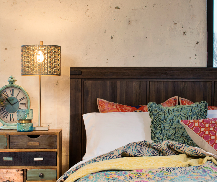 A fun mix of pillows and accessories add to the bohemian decorating vibe