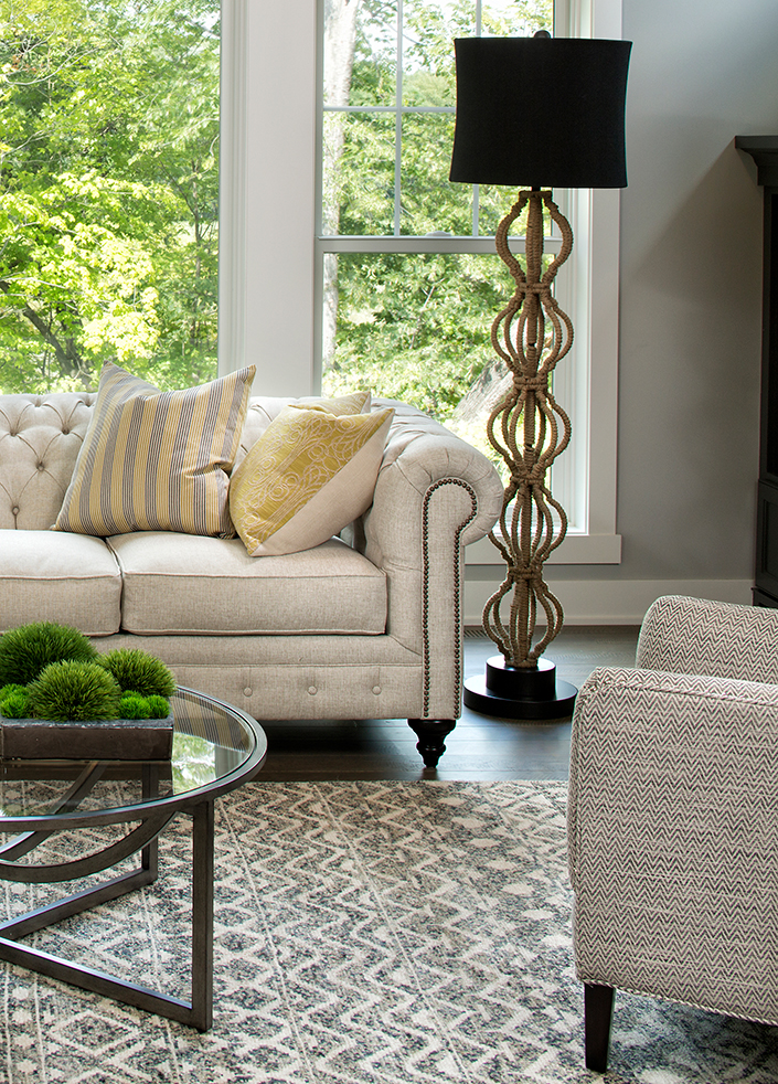 love this living room with the chesterfield sofa. (and that lamp!!!)