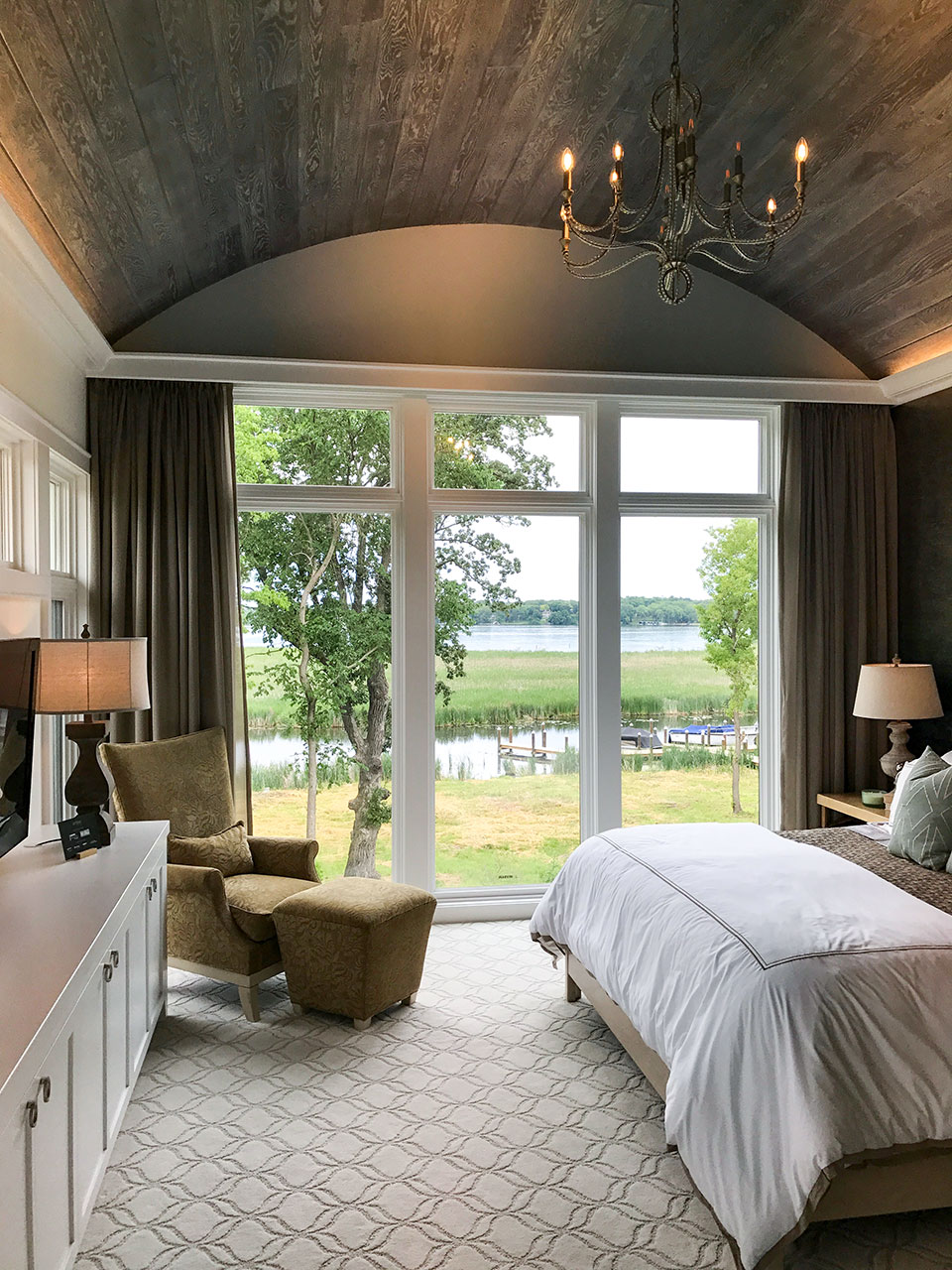 artisan home tour master bedroom suite with barrel vaulted gray reclaimed wood ceiling - beautiful window wall with lake views