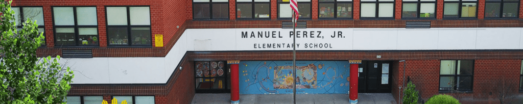The front entrance to Manuel Perez, Jr, Elementary School displays a beautiful mural.