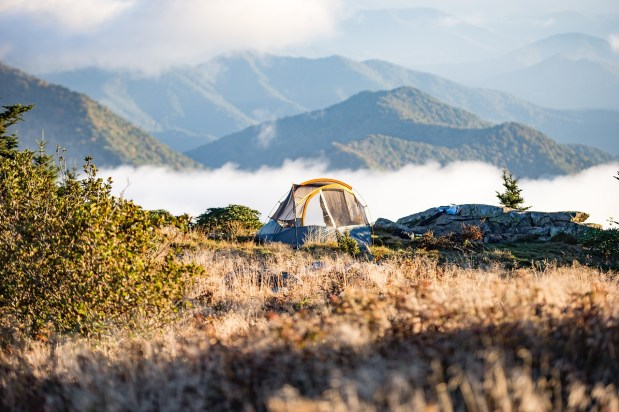 TENT ON A HILLSIDE