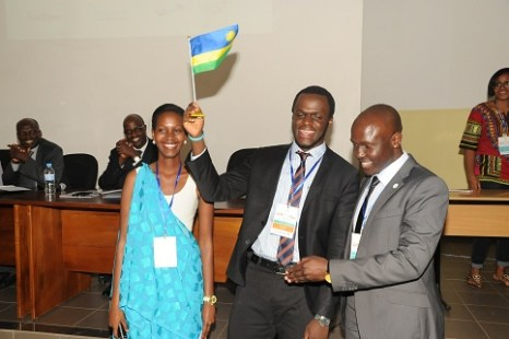Israel raises the Rwandan flag after he was elected chairperson of IPRF-Africa Region (Source)