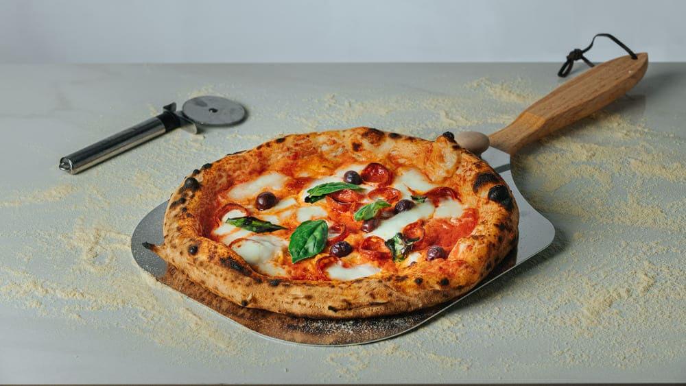 ¿Conoces la diferencia entre pizza romana y napolitana?