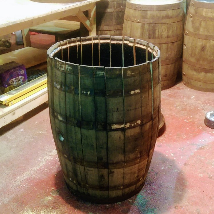 Whisky Barrel being taken apart for barrel staves