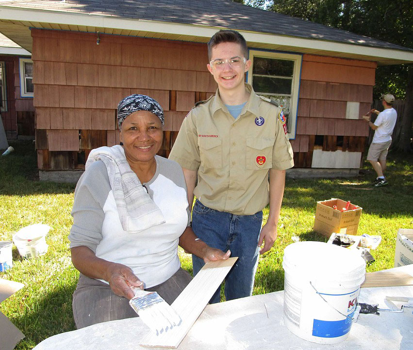 Homeowner Barbara Simms supports Boy Scout Trevor Mangum with his Eagle Project.