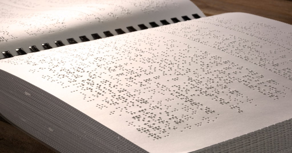 An inside spread of the Braille edition of the Wolf Handbook.