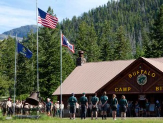 A flag ceremony at Camp Buffalo Bill