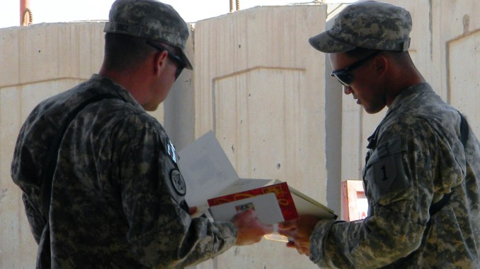 Soldiers looking at greeting card