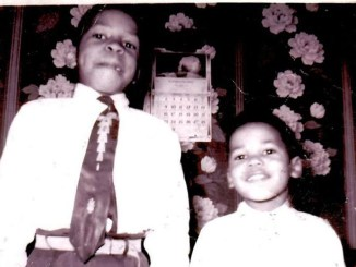 Elijah Cummings and his brother smile at the camera.