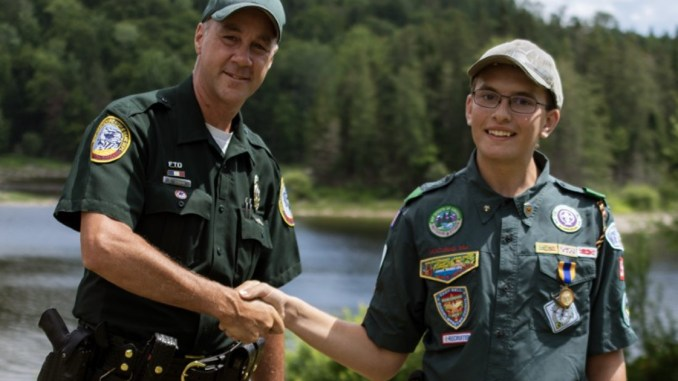 Kyle Dimick shakes hand of law enforcement officer