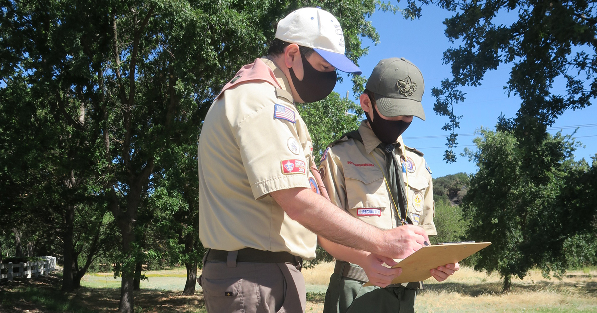 Trevor and his dad, Steve, look at clues during the mystery hike.