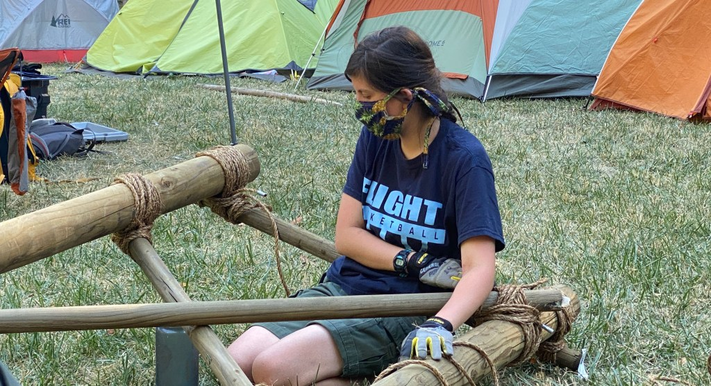 Olivia worked on a pioneering project at a Troop 582 SuperCamp in July.