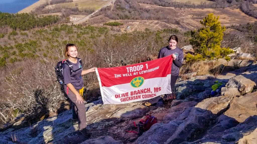 Anniston (left) and Ava represent their troop on a hike
