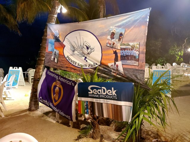 Picture of the sponsorship and event banners on a beach.