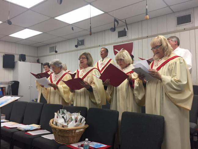 The choir sings at the Daytona Beach Drive-In Church