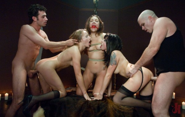 Tied up and gagged brunette has her nipples sucked by vampire chicks who get fucked