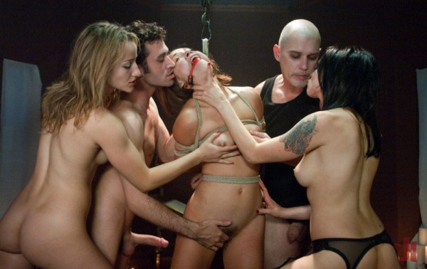 Tied up and gagged brunette is being petted by two vampire men and two vampire chicks