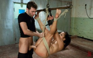 Tied up and suspended brunette gets her pussy fucked really hard