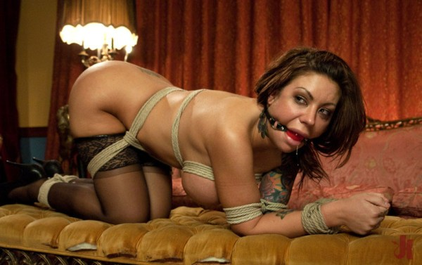 Tied up brunette in stockings drools through mouth gag
