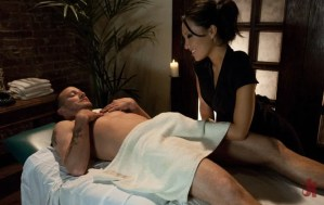 Asian masseuse gives stud a lovely hand-job on the massage table in rough bondage sex