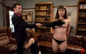 Ginger woman sucks Master's cock while another gets her breasts flogged in bdsm extreme sex