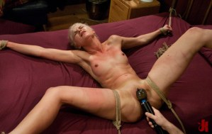 Sultry, submissive blonde is tied to a bed, spread open and has her pussy rubbed with a toy