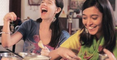 A shot from the film Margarita With A Straw, showing actors Kalki Koechlin and Sayani Gupta laughing.