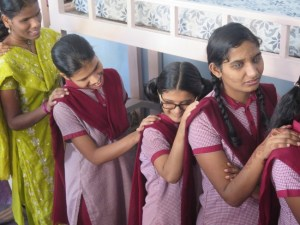 A group of young VI women standing in a line