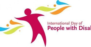 This is a logo of the International Day of People with Disability. It has a figure casually standing next to the words International Day of People with Disabilities. On either side of the figure, colourful ribbons fly.