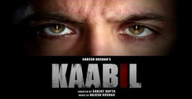 A poster of the movie Kaabil. The picture has a close-up of the actor Hrithik Roshan's face, he has a furrowed brow and each eye has the reflection of a lit candle in it. Below the photo, there is text in upper case that reads, 'Rakesh Roshan's Kaabil. Directed by Sanjay Gupta. Music by Rajesh Roshan.'